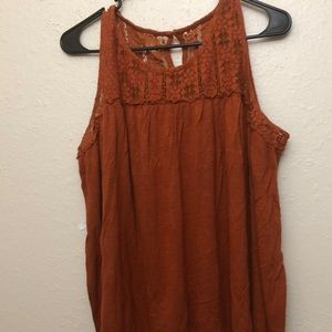 Orange tank top with lace on top portion.